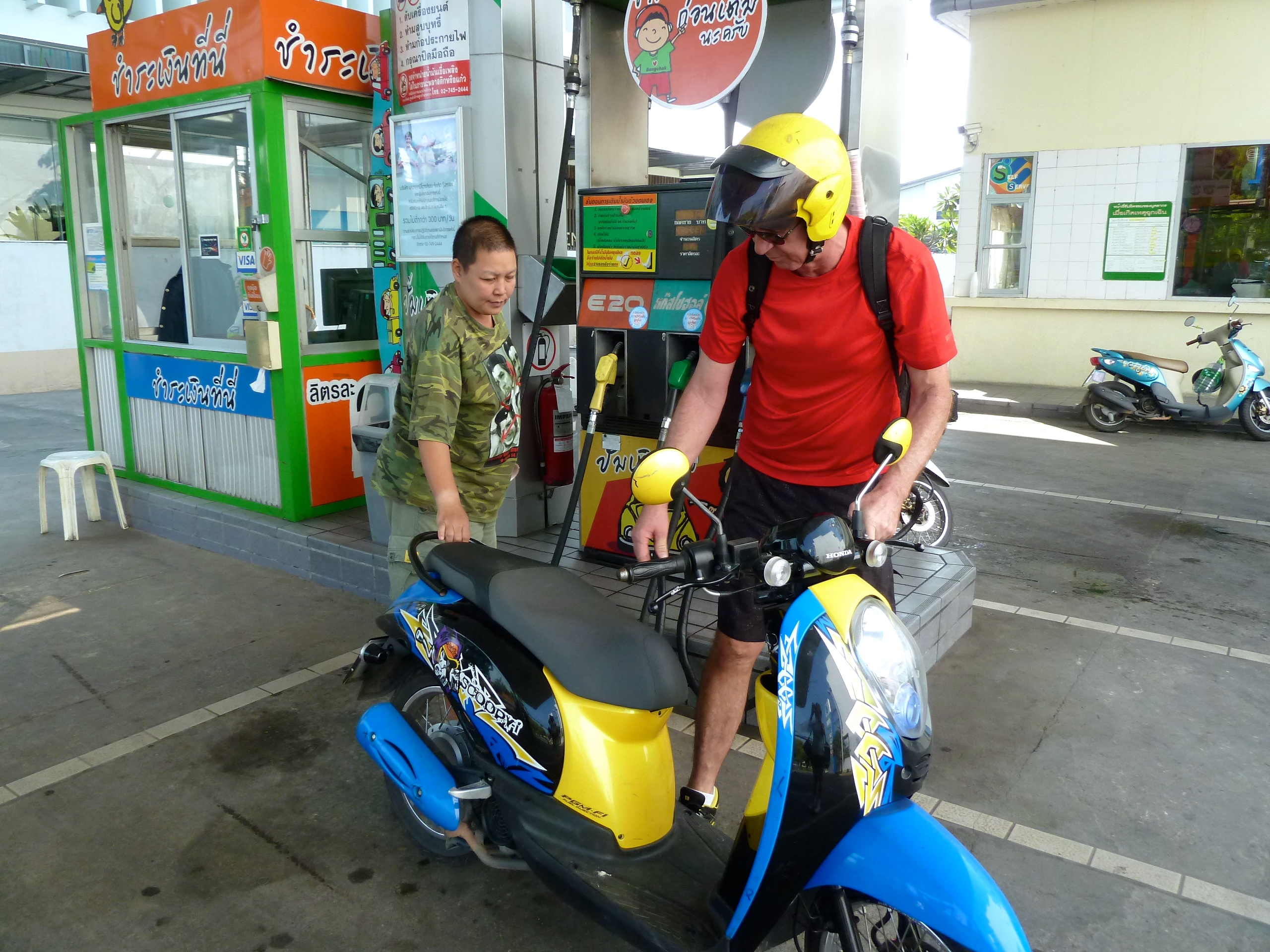breakpoint-travel-guides-chiang-mai-thailand-motorcycle-and-attendant-at-gas-station-teri-church